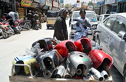 August 3, 2017 - Pakistan - QUETTA, PAKISTAN, AUG 03: Street vendor sells used motorcycle parts to earn his .livelihood for support his family, on his pushcart at roadside in Quetta on Thursday, August 03, .2017. (Credit Image: © PPI via ZUMA Wire)