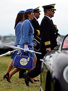 © Licensed to London News Pictures. 16/09/2012. Goodwood, UK . People enjoy the atmosphere at the 2012 Goodwood Revival. The event recreates the glorious days of motor racing and participants are encouraged to dress in period dress. Photo credit : Stephen Simpson/LNP