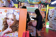 girls photo booth in gaming arcade Japan