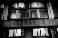 Fortress-like do-ya, the lowest level of boarding house, inhabited by day labourers and other men who cannot afford the deposits for an apartment, Sanya, Tokyo, Japan.  The men who stay at this do-ya for Y1,000 (US$10) are one short step from having to live on the streets.
