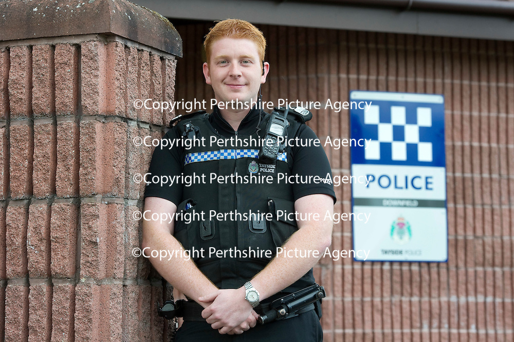 Tayside Police Officer PC Paul Radley outside Downfield Police Station in Dundee, PC Radley is to receive a bravery award for a resuce from a burning house....05.09.11<br /> Picture by Graeme Hart.<br /> Copyright Perthshire Picture Agency<br /> Tel: 01738 623350  Mobile: 07990 594431