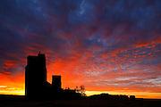 Grain elevators at sunrise in ghost town.<br /> Lepine<br /> Saskatchewan<br /> Canada