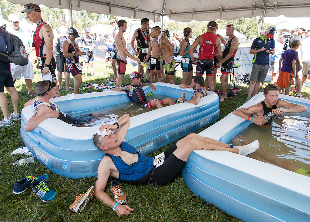 Omaha, Nebraska --<br /> <br /> Athletes including Lee Babcock of Kensington, Maryland, bottom, cool off in pools of cold water after competing in the Olympic-Distance National Championships triathlon at Levi Carter Park on Saturday, Aug. 13, 2016, in Omaha.<br /> <br /> MATT DIXON/THE WORLD-HERALD