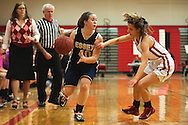 Essex's Olivia Duncan (40) drives past CVU's Laura Durkee (10) during the girls basketball game between the Essex Hornets and the Champlain Valley Union Redhawks at CVU high school on Tuesday night January 26, 2016 in Hinesburg. (BRIAN JENKINS/for the FREE PRESS)