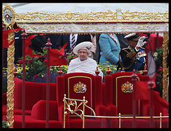 The Queen on board the Royal Barge the Spirit of Chartwell during  Thames Diamond Jubilee Pageant in London, Sunday 3rd  June 2012.  Photo by: Stephen Lock / i-Images