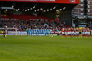 Players of both teams observe a minute silence to honour the Hillsbrough Tragedy's 25th anniversary prior to the  Sky Bet Championship match at The Valley, London<br /> Picture by David Horn/Focus Images Ltd +44 7545 970036<br /> 15/04/2014