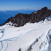The fractured Ingraham Glacier is shown with a camp set up below Cathedral Rocks during a summit of Mount Rainier on June 30, 2015. The iconic Pacific Northwest volcano is a popular challenge for mountaineers.  (Joshua Trujillo, seattlepi.com)