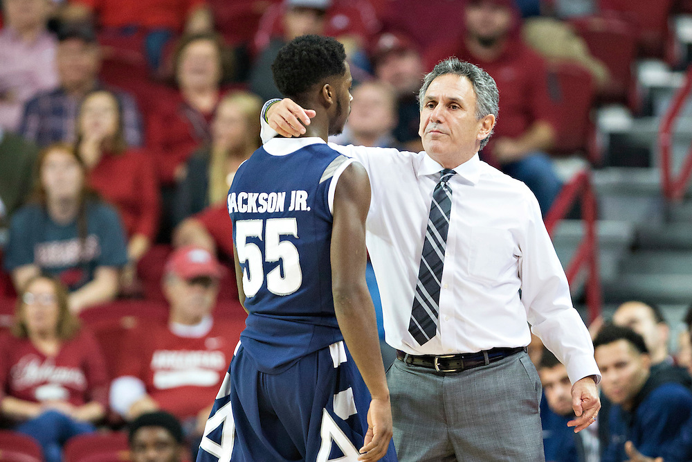 FAYETTEVILLE, AR - NOVEMBER 18:  Head Coach Keith Dambrot talks with Antino Jackson #55 of the Akron Zips during a game against the Arkansas Razorbacks at Bud Walton Arena on November 18, 2015 in Fayetteville, Arkansas.  The Zips defeated the Razorbacks 88-80.  (Photo by Wesley Hitt/Getty Images) *** Local Caption *** Keith Dambrot; Antino Jackson