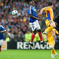05 September 2009: French defender Lassana Diarra vies with Romanian player Maximilian Nicu during the World Cup 2010 qualifying football match France vs. Romania (1-1), on September 5, 2009 at the Stade de France stadium in Saint-Denis, near Paris, France.