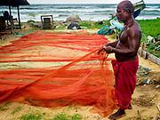 07 OCTOBER 2017 - MORATUWA, SRI LANKA: A fisherman checks his nets in Moratuwa, a fishing village south of Colombo. Fish is an important source for many Sri Lankans.  PHOTO BY JACK KURTZ
