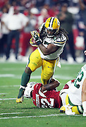 Green Bay Packers running back Eddie Lacy (27) gets tackled by Arizona Cardinals strong safety Tony Jefferson (22) as he runs the ball in the second quarter during the NFL NFC Divisional round playoff football game against the Arizona Cardinals on Saturday, Jan. 16, 2016 in Glendale, Ariz. The Cardinals won the game in overtime 26-20. (©Paul Anthony Spinelli)