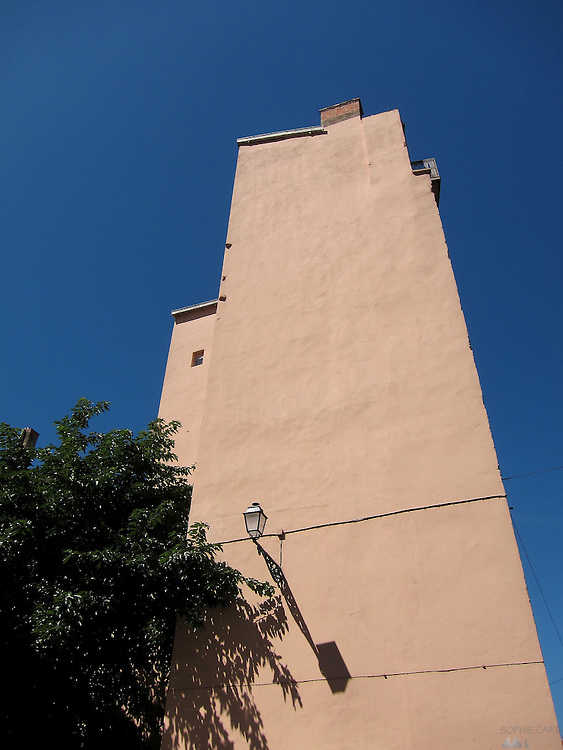 A tall pink building in Lyon's old town, France