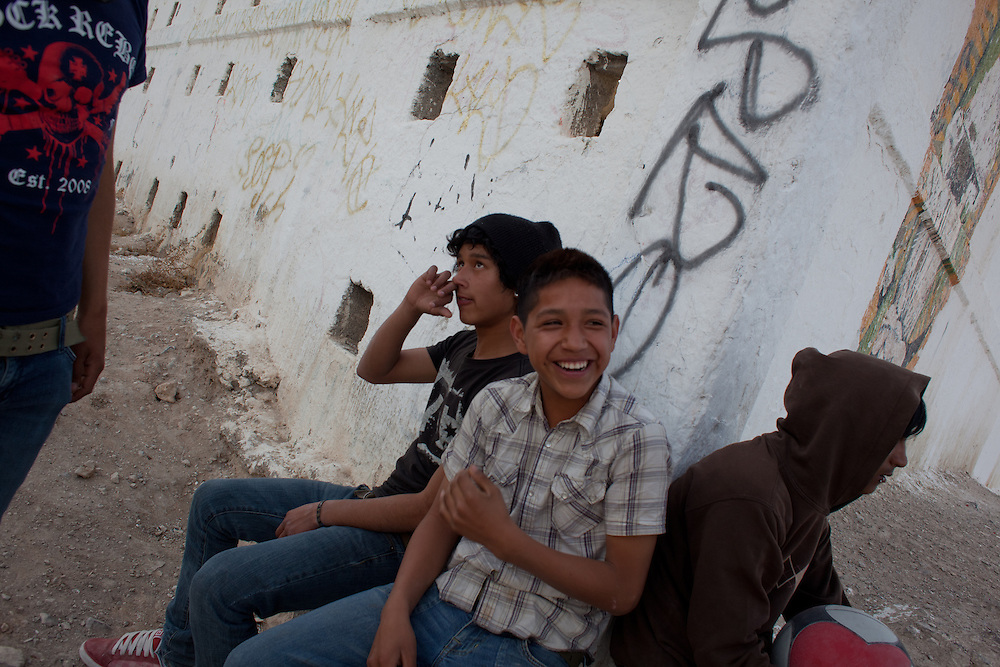Youth hang out in the Diaz Ordaz colonia, one of the poorest neighborhoods of Ciudad Juarez.