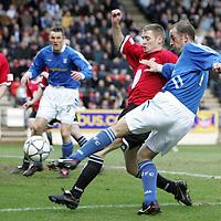 St Johnstone v St Mirren...11.02.06.<br />Paul Sheerin gets a shot in on goal despite the efforts of David Van Zanten<br /><br />Picture by Graeme Hart.<br />Copyright Perthshire Picture Agency<br />Tel: 01738 623350  Mobile: 07990 594431