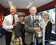 Doug Cowie and family with the SPFL Championship trophy after the man who has made the most ever appearances for Dundee opened the new Doug Cowie Press Lounge at Dens Park.<br /> <br /> LtoR: Douglas Cowie jnr, Gayle Cook (Doug's granddaughter), Doug Cowie, Gloria McIntyre (Doug's daughter)<br /> <br />  - Dundee v Raith Rovers, Scottish League Cup at Dens Park<br /> <br />  - &copy; David Young - www.davidyoungphoto.co.uk - email: davidyoungphoto@gmail.com