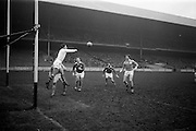 16/02/1964<br /> 02/16/1964<br /> 16 February 1964<br /> Railway Cup Football Semi Final: Munster v Ulster at Croke Park, Dublin. Ulster goalie S. Hoare punches the ball clear into the hands of M. O'Connell coming up on right.