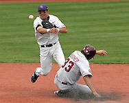 Kansas State second basemen Eddie Vasquez (L) throws to first base after forcing out Oklahoma's Joseph Hughes (33) at second base in the top of the seventh inning at Tointon Stadium in  Manhattan, Kansas, April 22, 2007.  Oklahoma defeated Kansas State 12-4.