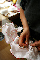 Louise Feuillère making lingerie, brassieres, for order and by hand