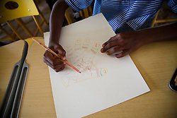 Students at the primary school in Bosomkyekye  make art out of traces of their hands during an art program with CARE staff in conjunction with the celebration for CARE's 20th anniversary in Atlanta.CARE has several programs in this area, including the REGAL program for students and a training program for teachers.