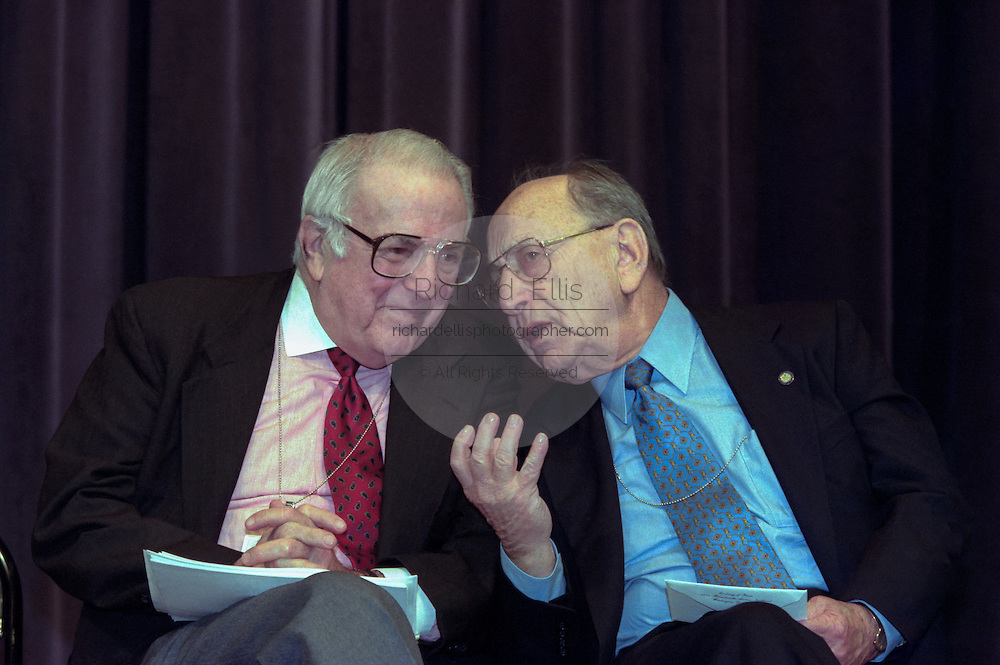 United States Holocaust Memorial Museum Chairman Miles Lerman talks with Federal Judge Abner Mikva (left) at the opening ceremony for the Conference on Holocaust-Era Assets at the US Holocaust Museum November 30, 1998 in Washington, DC.