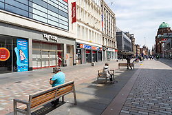 View of closed shops and few people on Argyle Street in Glasgow city centre during covid-19 lockdown, Scotland, UK