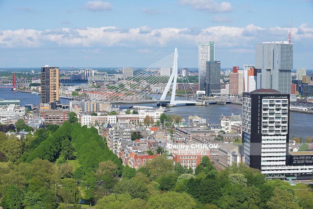 ROTTERDAM, NETHERLANDS - JUNE 02, 2013: Aerial view to the modern buildings of Rotterdam and Erasmus bridge in Rotterdam, Netherlands.