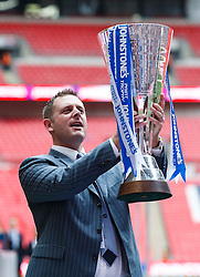 Peterborough Chairman Darragh MacAnthony celebrates with the trophy after a 3-1 win in the match - Photo mandatory by-line: Rogan Thomson/JMP - 07966 386802 - 30/03/2014 - SPORT - FOOTBALL - Wembley Stadium, London - Chesterfield FC v Peterborough United - Johnstone's Paint Trophy Final.