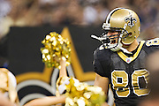 NEW ORLEANS, LA - DECEMBER 26:   Jimmy Graham #80 of the New Orleans Saints runs through the tunnel onto the field before a game against the Atlanta Falcons at Mercedes-Benz Superdome on December 26, 2011 in New Orleans, Louisiana.  The Saints defeated the Falcons 45-16.  (Photo by Wesley Hitt/Getty Images) *** Local Caption *** Jimmy Graham