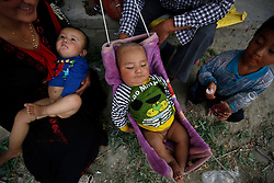 A picture made available on 31 May 2013 of children of the Uighur ethnic group in a market in Yopurga village of Kashgar, western edge of China's Xinjiang Uighur Autonomous Region, China 25 May 2013. Uighurs, a Muslim ethnic minority group in China, make up about 40 per cent of the 21.8 million people in Xinjiang, a vast, ethnically divided region that borders Pakistan, Afghanistan, Kazakhstan, Kyrgyzstan and Mongolia. Other ethnic minorities living in here include the Han Chinese, Kyrgyz, Mongolian and Tajiks people. In the restive region of Kashgar, western end of Xinjiang where the North and South Silk road meets, Uighurs comprise of more than 90 per cent of the 3.9 million population. Most practice a moderate form of Islam and religion is a major part of most ordinary Uighurs' lives. Tensions have been high between the Uighurs and the dominant Han Chinese as Uighurs complain of cultural and religious repression and claim that Han Chinese migrants enjoy the main benefits of development in the oil-rich but economically backward region.