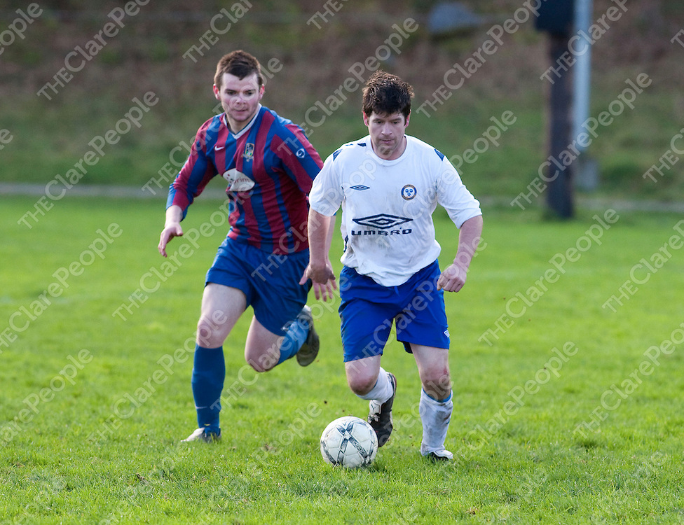 Shannon's Kieran Lake &amp; Ennis Town's Gary Walsh in action during their Game played in Ennis.<br /> Picture Credit  Brian Gavin Press 22