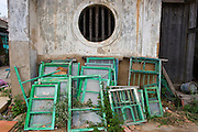 Discarded window frames on Kinmen, Republic of China ROC (Taiwan). ...Kinmen (Jinmen) formely known as Quemoy. The island lies less than 2km off the coast of China, and in 1949 was turned into a front-line of defense for Taiwan by Chiang Kai-shek and the Chinese nationalist Kuomintang (KMT) in the ongoing war with the communist PRC. The island existed under martial law until 1993. Today, Kinmen is a popular tourist destination and home to a lot of traditional Fujian-style architecture.