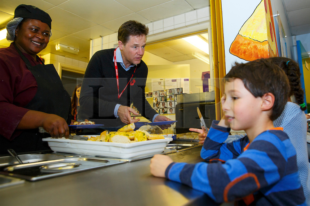 © Licensed to London News Pictures. 03/11/2014. LONDON, UK. The Deputy Prime Minister Nick Clegg serving lunch to school children at Weston Park Primary School in Crouch End, London on Monday 3 November 2014. Photo credit : Tolga Akmen/LNP