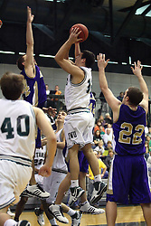 30 December 2006: Jason Bloom attempts a shot from the lane.The Titans outscored the Britons by a score of 94-80. The Britons of Albion College visited the Illinois Wesleyan Titans at the Shirk Center in Bloomington Illinois.<br />