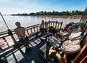 Laos, Champasak province. Vat Phou Cruise. No shoes allowed on board; passengers' shoes are stored outside for shore excursions.