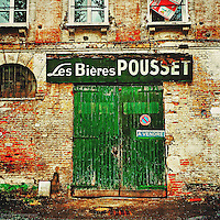 Vintage French building with green doors