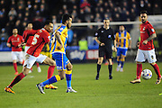 Dominic Smith of Shrewsbury Town clears under pressure from Jacob Murphy of Coventry City FC (on loan from Norwich City) during the Sky Bet League 1 match between Shrewsbury Town and Coventry City at Greenhous Meadow, Shrewsbury, England on 8 March 2016. Photo by Mike Sheridan.