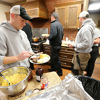 Chad Wheeler, a Tupelo Firefighter, loads up his biscuit with jelly as he gets breakfast with his fellow firefighters from B shift on Christmas morning at Tupelo Fire Station number 1. All seven Tupelo Fire Stations came together for the meal.