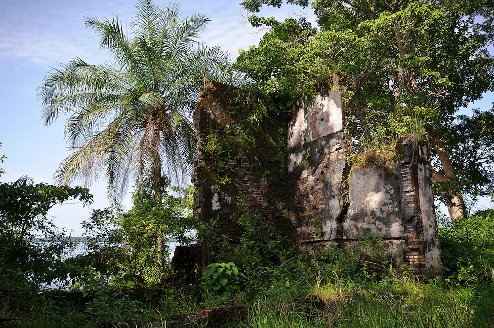Between 1750 and 1800, Bunce Island was one of the major slave trading centres on the Rice Coast of West Africa and the island played a significant part in the British slave trade.  Its strategic location at the limit of navigation in Africa's largest natural harbour made the island an ideal base for European slave traders.  Slaves were purchased from inland traders sailing down from the interior, sold on and then shipped to the Caribbean and the American South.  Local slaves from this part of Africa were particularly valued in the British rice plantations of South Carolina and Georgia and as a result, thousands of slaves were shipped directly from Bunce to these colonies.  Slave ships from Newport (Rhode Island), New London (Connecticut), Salem (Massachusetts) and New York also regularly called at Bunce.  Because of this direct connection between the island and the USA, Bunce Island is though to be one of the most significant historical slave trade sites for African Americans today...Bunce Island is now a National Historic Site and protected by the Sierra Leone government.  Some restoration and clearing work has already taken place and the site has been mapped by the US Parks Service.  The island has also been the scene of several 'home comings' by members of the Gullah community - descendants of slaves transported through Bunce to South Carolina and Georgia.