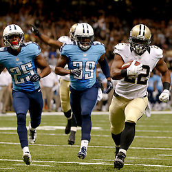 Aug 15, 2014; New Orleans, LA, USA; New Orleans Saints running back Mark Ingram (22) runs for a touchdown against the Tennessee Titans during a preseason game at Mercedes-Benz Superdome. Mandatory Credit: Derick E. Hingle-USA TODAY Sports