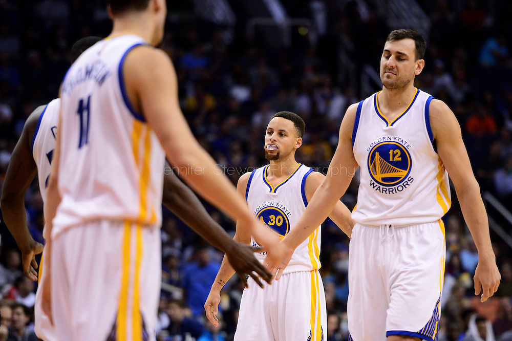 Feb 10, 2016; Phoenix, AZ, USA; Golden State Warriors guard Stephen Curry (30) and center Andrew Bogut (12) high five teammates guard Klay Thompson (11) and forward Draymond Green (23) at Talking Stick Resort Arena. The Golden State Warriors won 112-104. Mandatory Credit: Jennifer Stewart-USA TODAY Sports