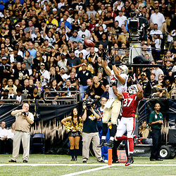Sep 22, 2013; New Orleans, LA, USA; New Orleans Saints tight end Jimmy Graham (80) catches a touchdown over Arizona Cardinals strong safety Yeremiah Bell (37) during a game at Mercedes-Benz Superdome. The Saints defeated the Cardinals 31-7. Mandatory Credit: Derick E. Hingle-USA TODAY Sports