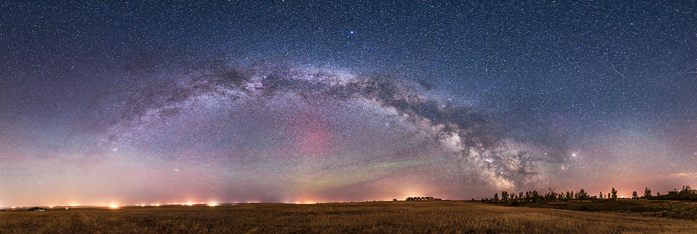 A 240&deg; panorama of the Milky Way on an early May night, in the wee hours at about 2 am with the Milky Way rising across the east. Cassiopeia and Perseus are at left, Cygnus at centre, and Sagittarius at right low on the horizon. At far right is Mars (brightest) and Saturn above Antares in Scorpius low in the south. <br /> <br /> A faint aurora and possibly airglow adds some green and red at centre.<br /> <br /> I shot this from the field next to my rural yard in southern Alberta. Lights from farms and gas plants mar the horizon and brighten the sky to the north and east. I shot this as a test of the iOptron iPano motorized panning mount. This is a stitch of 32 segments (!), shot in 4 rows or tiers of 8 segments each, with the 35mm lens at f/2 and stock Canon 6D at ISO 4000. <br /> <br /> All segments developed in Camera Raw, then exported to TIFFs to import into PTGui software. I used the Equirectangular projection to stitch the segments. Final processing of the flattened panorama in Photoshop.<br /> <br /> The original is 25,400 x 8,500 pixels.