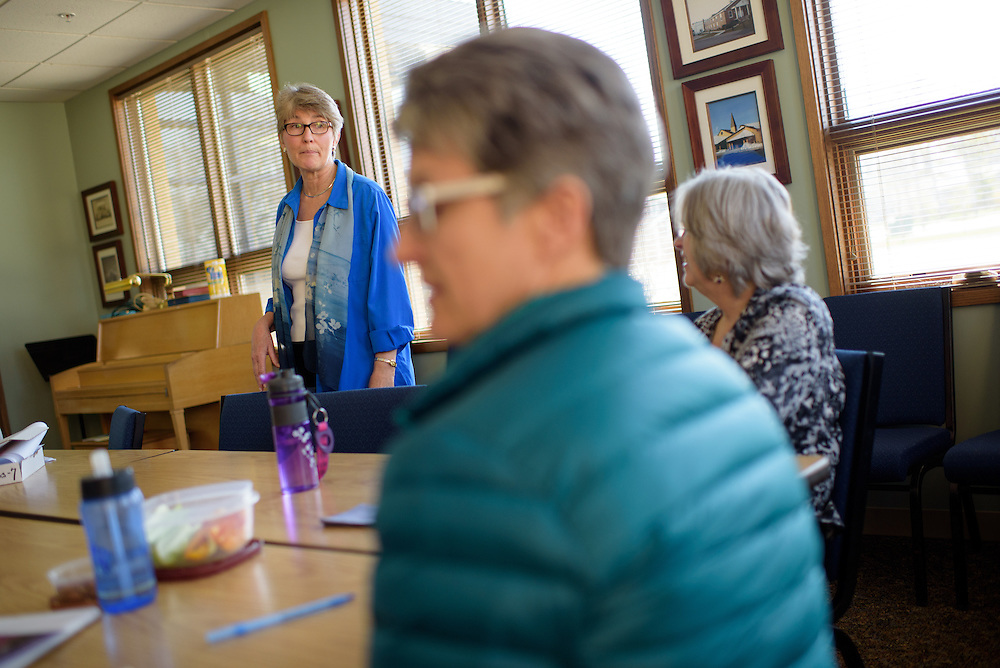 Chris Damon, executive director, CareSmart Illinois gives a workshop on caring for patients with dementia to Gayle Florian, center, and Ann Bartley-Arquilla, right, Friday, April 15, 2016, at Wildwood Presbyterian Church in Grayslake. A new Illinois Law, the CARE Act, requires hospitals to ask a patient to designate a caregiver upon admission to the hospital. (Photo by Rob Hart)