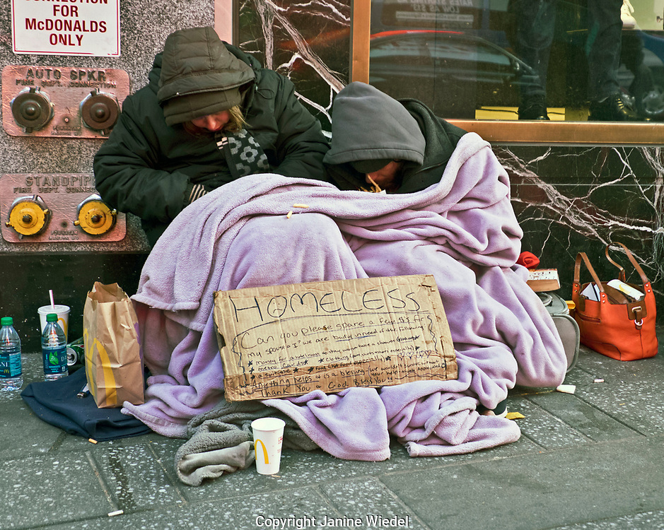 Homeless couple begging on streets of Manhattan New York City USA