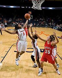 Virginia guard Paulisha Kellum (3) grabs a rebound against Davidson.  The Virginia Cavaliers women's basketball team defeated the Davidson Wildcats 83-68 at the John Paul Jones Arena in Charlottesville, VA on December 20, 2007.