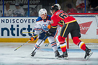 PENTICTON, CANADA - SEPTEMBER 8: Brett Pollock #60 of Calgary Flames checks Ethan Bear #74 of Edmonton Oilers during second period on September 8, 2017 at the South Okanagan Event Centre in Penticton, British Columbia, Canada.  (Photo by Marissa Baecker/Shoot the Breeze)  *** Local Caption ***