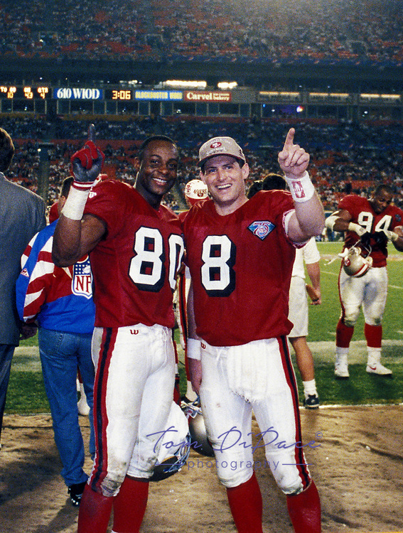San Francisco 49ers Jerry Rice and Steve Young celebrate on the bench during the game against the San Diego Chargers in Super Bowl XXIX at Joe Robbie Stadium in Miami, Florida on January 29,1995.The 49ers defeated the Chargers 49-26.<br />  ( Photo/Tom DiPace)