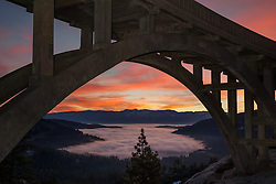 """Sunrise at Rainbow Bridge 1"" - This colorful sunrise was photographed at Rainbow Bridge, above a fog covered Donner Lake and Truckee, California."