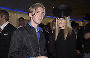 Philip Treacy and Eloise Anson, I.D. magazine dinner for John Dempsey of Mac cosmetics, Fifth floor restaurant, Harvey Nichols. 17 December 2002. © Copyright Photograph by Dafydd Jones 66 Stockwell Park Rd. London SW9 0DA Tel 020 7733 0108 www.dafjones.com