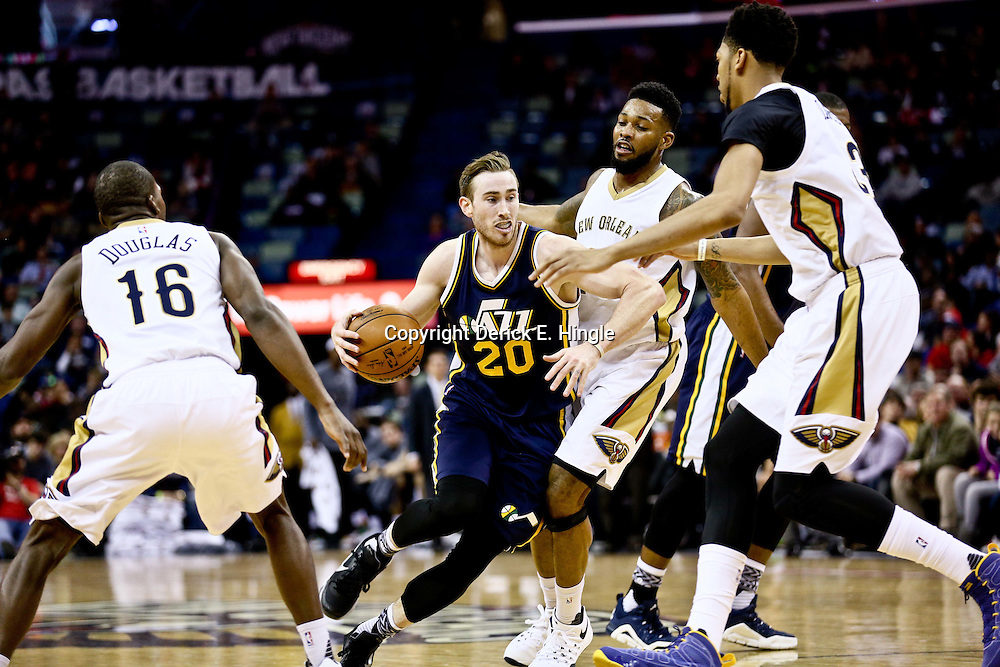 Feb 10, 2016; New Orleans, LA, USA; Utah Jazz forward Gordon Hayward (20) drives by New Orleans Pelicans guard Toney Douglas (16) and forward Alonzo Gee (15) and forward Anthony Davis (23) during the second half of a game at the Smoothie King Center. The Pelicans defeated the Jazz 100-96. Mandatory Credit: Derick E. Hingle-USA TODAY Sports